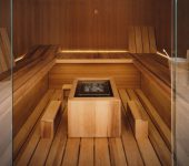 Air sauna with heat-treated aspen wood fittings and teak wood wall